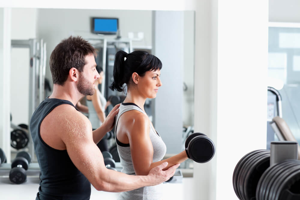 personal trainer with female client