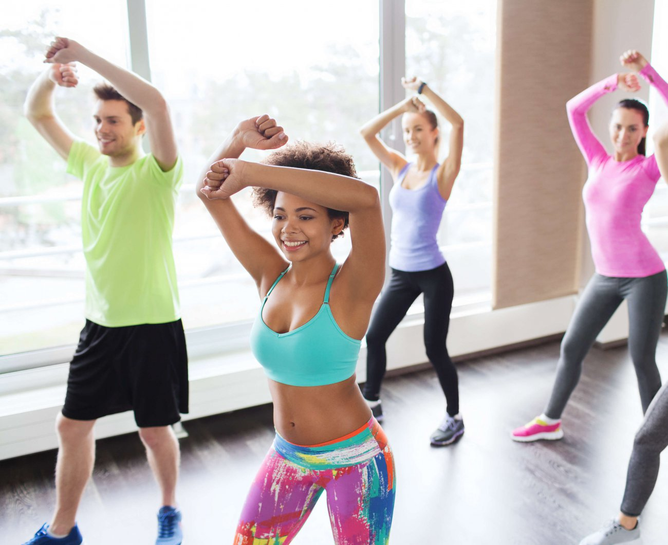 Five people taking part in a dance class