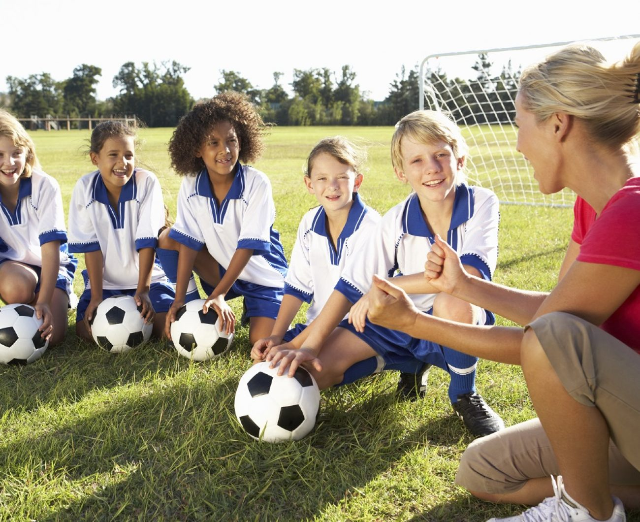 Female football coach and team