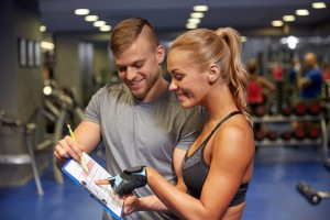 personal trainer with client plan
