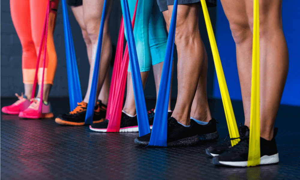 People using colourful resistance bands