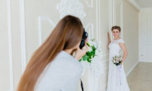 Woman photographing bride