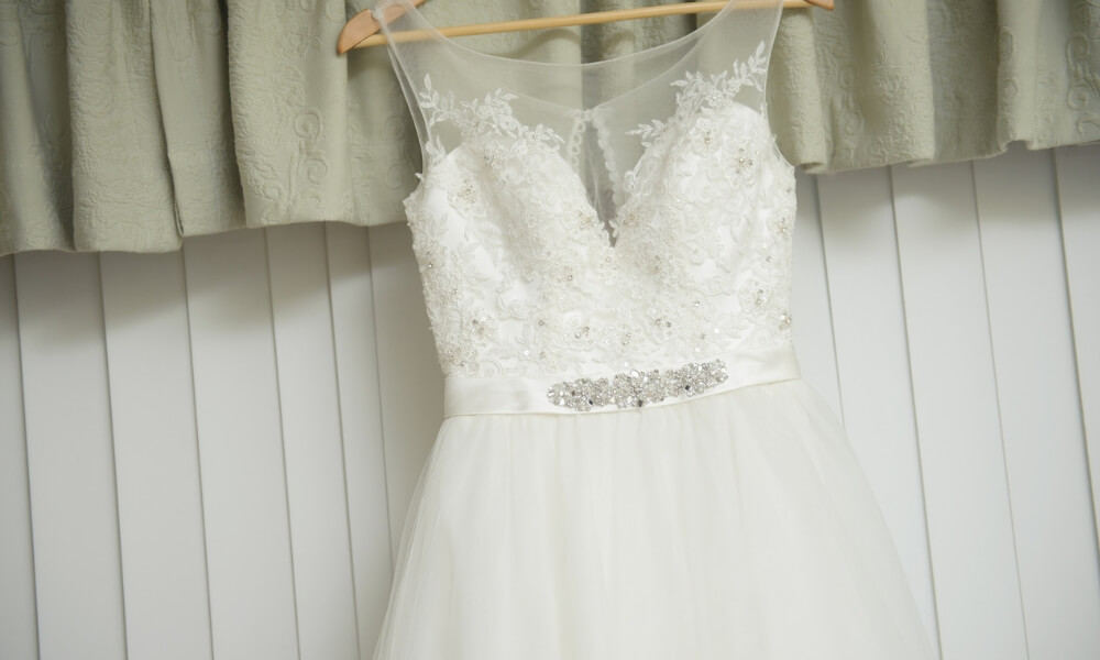 A wedding dress hanging up