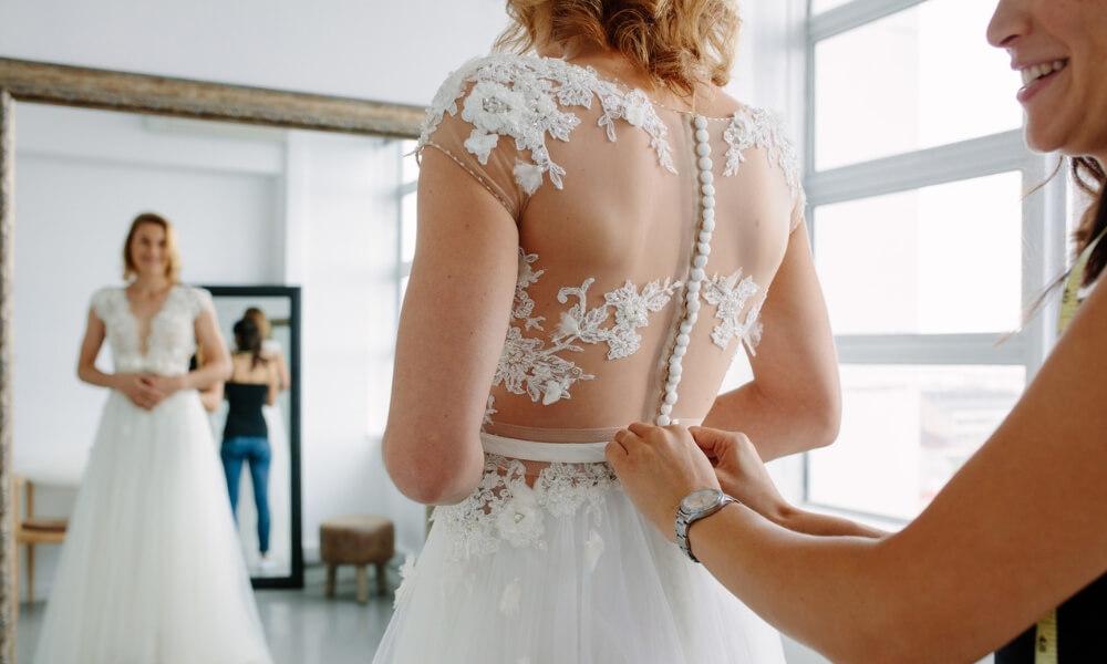 Wedding dress fitting in shop